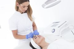 Young adult woman having a mesotherapy treatment. Does anyone ready for mesotherapy? Let`s go for some beauty treatment Royalty Free Stock Image