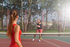 Young adult woman playing tennis and preparing for sports competition. Royalty Free Stock Photos