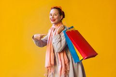 Young adult woman pointing finger on bags and looking at camera Royalty Free Stock Photo