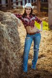 Young adult woman posing on farmland Stock Image