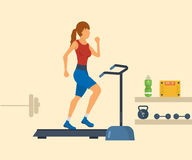 Young adult woman running on treadmill in fitness Royalty Free Stock Photos
