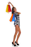 Young adult woman with shopping bags Stock Images