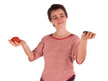 Young adult woman with short hair  a red top, blue jeans on white background in different poses, and various facial expressions. N Royalty Free Stock Photos