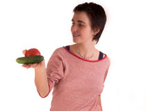 Young adult woman with short hair  a red top, blue jeans on white background in different poses, and various facial expressions. N Stock Photo