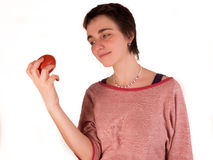Young adult woman with short hair  a red top, blue jeans on white background in different poses, and various facial expressions. N Stock Photos