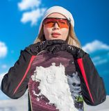 Young adult woman snowboarder holding snow board. Young adult woman snowboarder holding board in heand in snow winter stock image