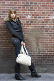 Young Adult Woman Standing with Purse in Hand Royalty Free Stock Images