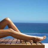 Young adult woman is sunbathing Royalty Free Stock Photography