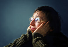 Young adult woman thinking. Royalty Free Stock Images