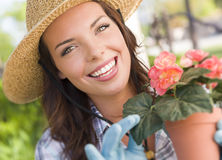 Young Adult Woman Wearing Hat Gardening Outdoors Royalty Free Stock Photo