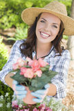 Young Adult Woman Wearing Hat Gardening Outdoors Stock Photo