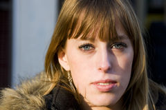 Young Adult Woman With Serious Expression Royalty Free Stock Photos