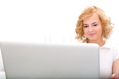 Young adult woman working on a Laptop Stock Image