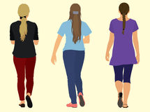 Young Adult Women Walking. Three Young Women in Casual Clothes Walking Away Stock Photos