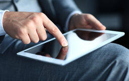 Young adult working on a digital tablet Stock Photo