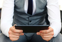Young adult working on a digital tablet Royalty Free Stock Photography