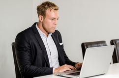 Business man working with laptop Stock Images