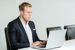 Business man working with laptop Stock Photography