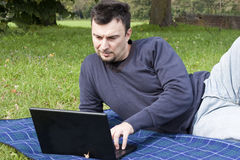 Young Adult Working Outdoors Stock Photo