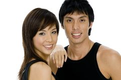 Young Adults. Two good-looking young asian adults in black on white background Royalty Free Stock Images
