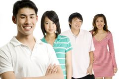 Young Adults. Four young asian adults standing in a group (shallow depth of field used Stock Images