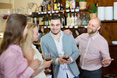 Young adults in bar. Group of young adults hanging out in bar with drinks. Selective focus Stock Images