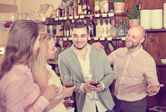 Young adults in bar. Group of young adults hanging out in bar with drinks. Selective focus Stock Photography