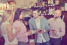 Young adults in bar stock photos