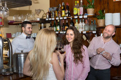 Young adults in bar Royalty Free Stock Photos