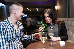 Young adults in cafe celebrating. Royalty Free Stock Photo