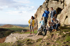 Young adults on country walk. Relaxing looking at the view Stock Photo