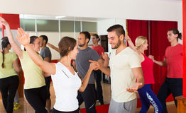 Young adults dancing in a studio Royalty Free Stock Images
