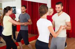 Young adults dancing in a studio. Energy young people having dance in class. Selective focus Stock Images