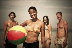 Young Adults enjoying themselves on a tropical beach Stock Photography