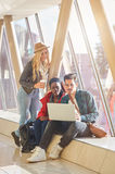 3 young adults entrepreneurs or students group mixed race around Royalty Free Stock Images