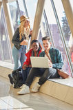 3 young adults entrepreneurs or students group mixed race around Stock Photos