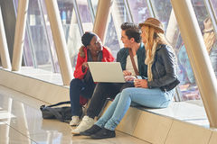 3 young adults entrepreneurs or students group mixed race around Stock Images