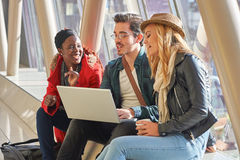 3 young adults entrepreneurs or students group mixed race around Royalty Free Stock Photos