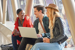 3 young adults entrepreneurs or students group mixed race around Stock Photo