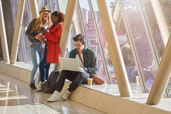 3 young adults entrepreneurs or students group mixed race around Stock Image