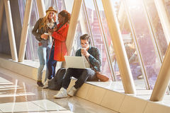 3 young adults entrepreneurs or students group mixed race around Royalty Free Stock Photography