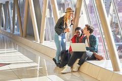 3 young adults entrepreneurs or students group mixed race around Royalty Free Stock Image