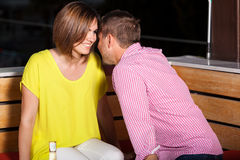 Young adults flirting at a bar Royalty Free Stock Images