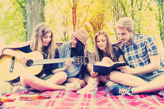 Young adults have fun with guitar Royalty Free Stock Photos