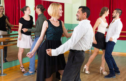 Young adults having dance class royalty free stock image