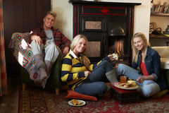 Young adults making toast on open fire Royalty Free Stock Photography