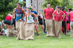 Young Adults Participate In Sack Race At Atlanta Field Day Royalty Free Stock Photography