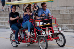 Young Adults Pedal A Four-Wheeled Cycle In Chicago Stock Image