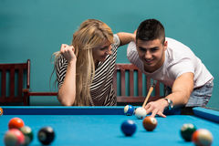 Young Adults Playing Pool Stock Photo