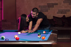 Young Adults Playing Pool Royalty Free Stock Image